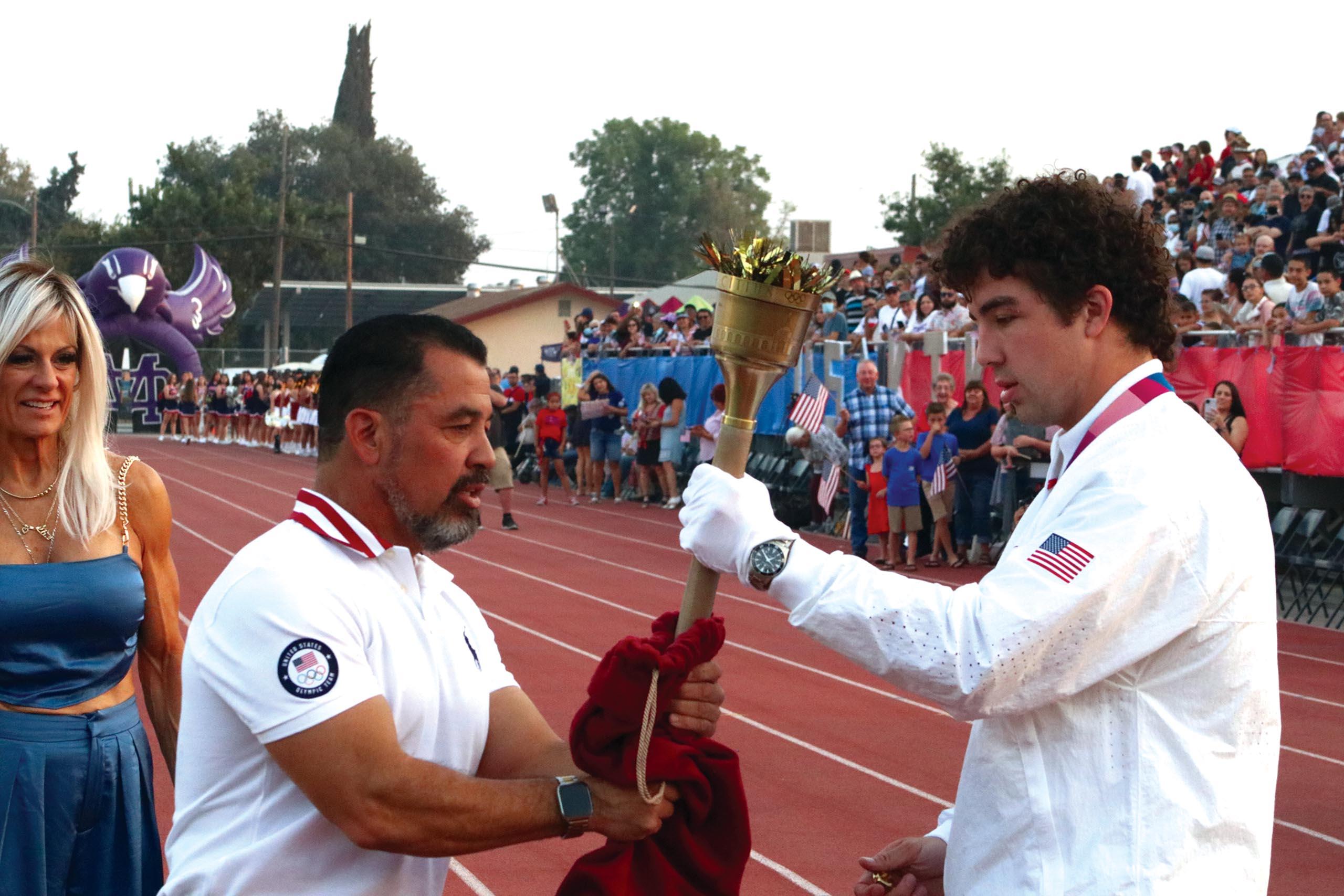 jj-sports-richard-torrez-day_dad-handing-torch